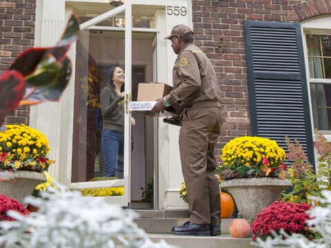 UPS driver dropping off package