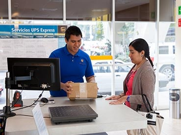 Man and woman looking at package