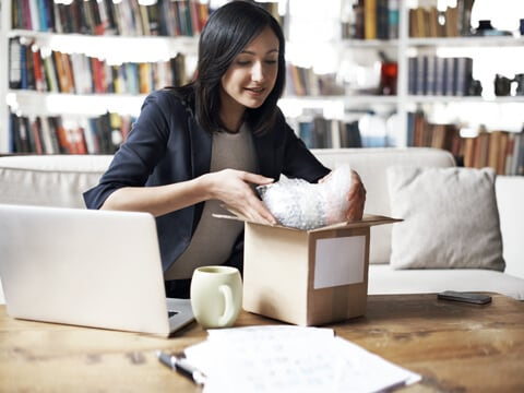 Woman preparing package to be shipped