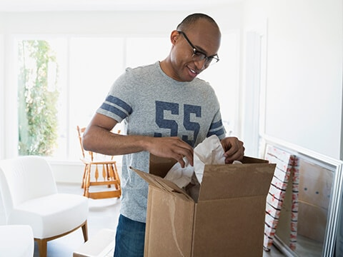 Man preparing package for return