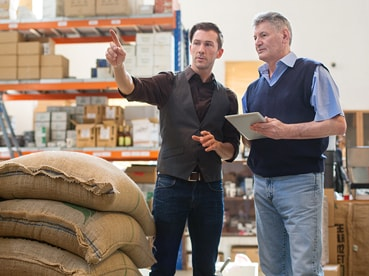 Men talking in UPS shipping warehouse