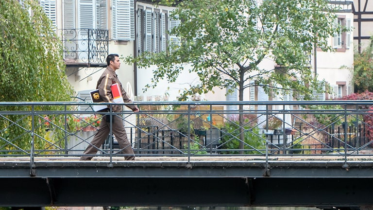 UPS delivery man holds package