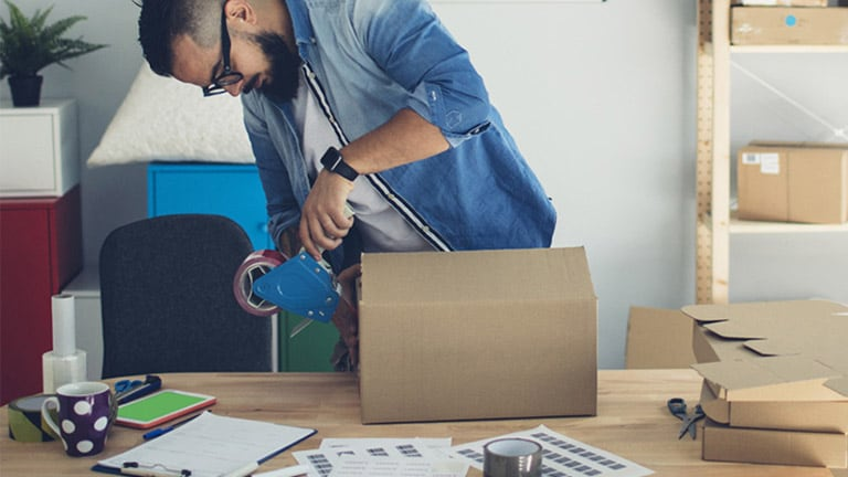 Man preparing package for shipping