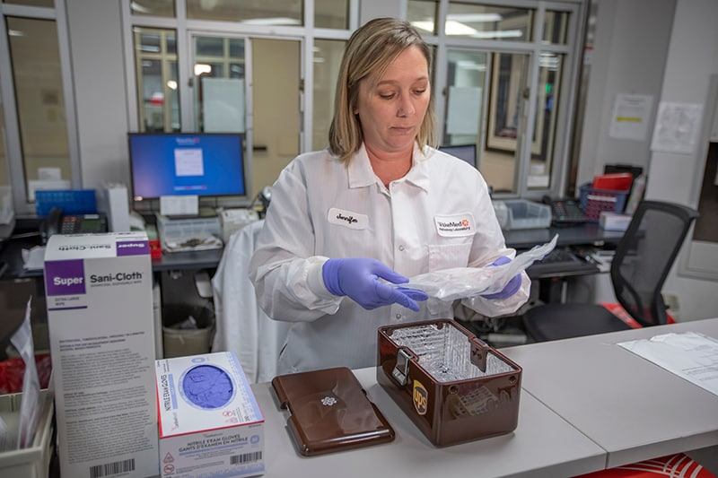 Woman preparing medical samples for drone delivery